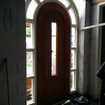 Binnenkant voordeur vanuit hal gezien